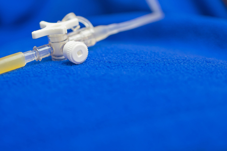 Close up saline IV drip for patient and Infusion pump in patient room. Stock Photo