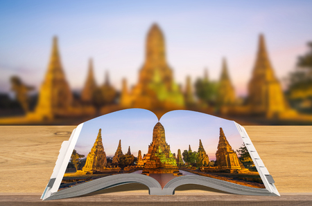 Creativity guidebooks travel, Open book on wooden table with blurred nature background, Scene Ayutthaya Historical Park.