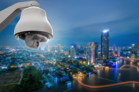 private room: CCTV monitoring, security cameras. Backdrop with views of the city during twilight.