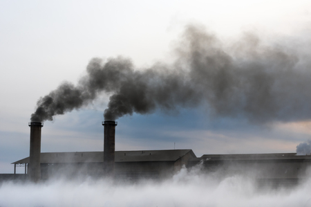 Air pollution with black smoke from chimneys and industrial waste. Reklamní fotografie