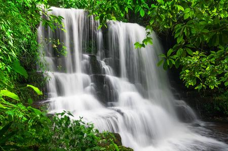 Man Daeng waterfall, Waterfall with autumn color change Beautiful nature.