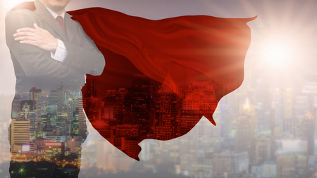 Double Exposure businessman superhero with skyline concept of success, leadership and victory in business,  Mixed Media. Stock Photo