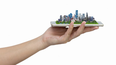 Modern city model on smartphone in womens hand holding isolated on white background with clipping path.