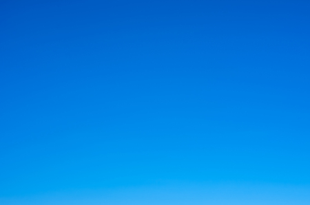 Clear sky, no clouds, perfect for backdrop.