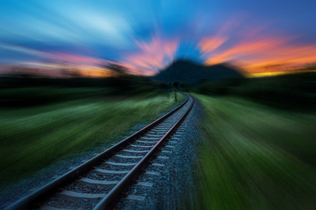 Railway or Railroad against beautiful evening sky at sunset with motion blurred, Industrial landscape in countryside. Banco de Imagens - 110675939