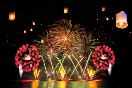 Beautiful firework and lantern display for celebration with blur bokeh light, happy new year and merry christmas. Stock Photo