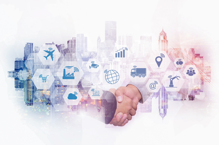 Double exposure of businessman handshake on cityscape background with Internet of things (IOT) objects icon and Internet networking concept, Connect global wireless devices with each other.