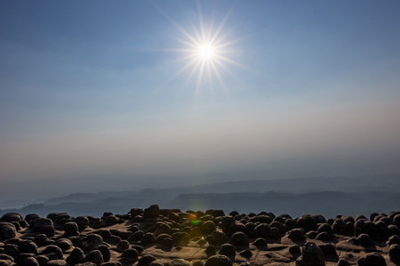 The sun with a fair light from the lens above the viewpoint of the knob stone ground, Phu Hin Rong Kla National Park. Stock fotó