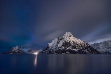 Beautiful Mt. Olstinden in Moskenes view of scenic Lofoten Islands archipelago winter scenery, Beautiful mountain landscape in winter Norway, Scandinavia.
