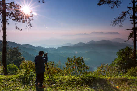 Tourists are taking pictures of the morning scenery of Doi Luang Chiang Dao from Doi Kham Fah Viewpoint, Pha Daeng National Park, Chiang Mai Province.