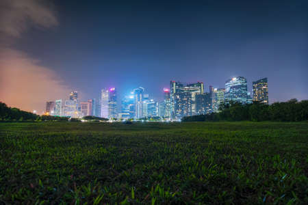 Twilight view of deserted park empty near Singapore downtown. Stock Photo