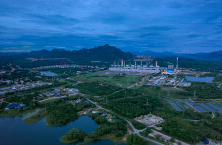Aerial view of the Mae Moh coal-fired power plant with smoke and air released from the chimney Industrial factory Electric tower in environmental energy concept Lampang, Thailand