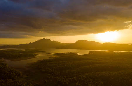 Beautiful Aerial view sundown over the mountain range at the north of thailand, Beauty rainforest landscape with fog in morning - Drone.