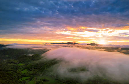 Beautiful Aerial view sunrise over the mountain range at the north of thailand, Beauty rainforest landscape with fog in morning Standard-Bild
