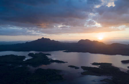 Beautiful Aerial view sunset over the mountain range at the north of thailand, Beauty rainforest landscape with fog in morning - Drone. Stock Photo