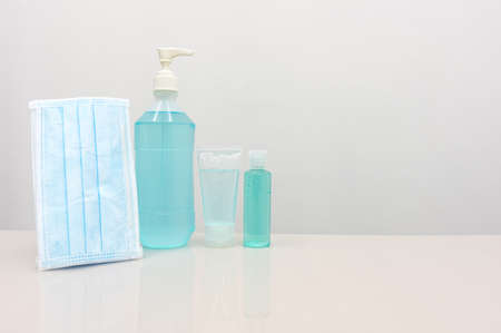 Coronavirus Prevention Equipment, Medical Surgical Mask Hand sanitizer on the white table, blank space for adding a campaign message to prevent the spread of disease to others. Stock Photo