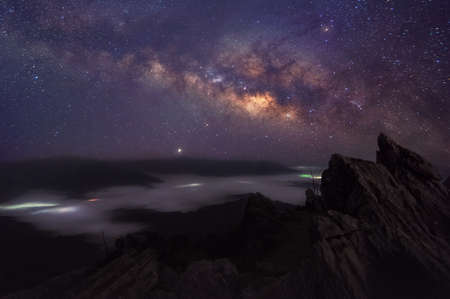 Milky Way Galaxy and Mountain landscape at Doi Pha Tang, Chiang Rai, Thailand, Doi Pha Tang offers the best spot to watch the scenic Mekong river at the hilltop and beautiful sunrise spotview.
