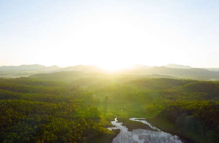 Beautiful Aerial view sunrise over the mountain range at the north of thailand, Beauty rainforest landscape with fog in morning- Drone.