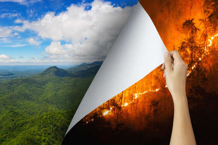Change concept, Hand turning pollution wildfire page revealing Nature landscape, changing reality, hope inspiration to environmental protection and environmental campaign. Stock Photo