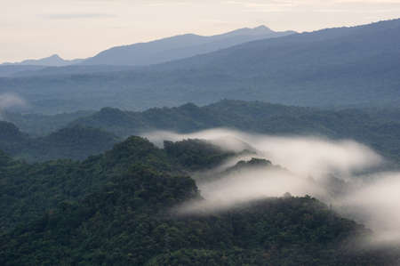 Beautifully Landscape Aerial view panoramic at sunrise with fog above mountain in Mae Moh, Lampang, Thailand, Drone.