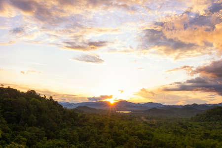 Scenic Sunset Landscape, Sun over Mountain at Mae Moh Lampang in thailand.