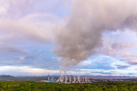 Smoke of cooling over coal power plant  Mae Moh Lampang at morning with rainbow, Bird eye view.