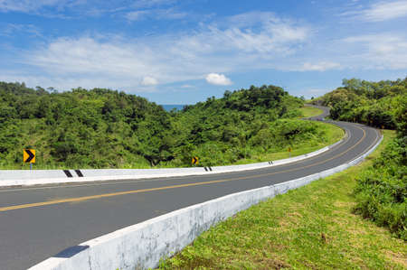 Road no.3 or Beautiful sky road over top of mountains with green jungle. Road trip on mountain in Nan province, Thailand. 写真素材