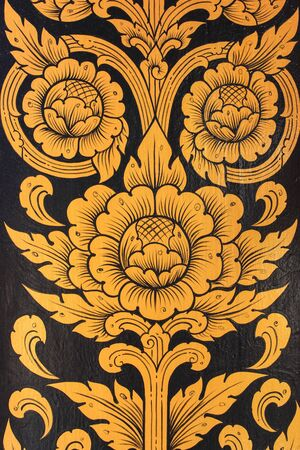A very old Thai Buddhist temple mural painted in black and gold, Thailand, Southeast Asia photo