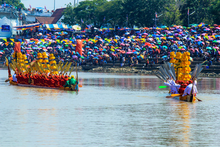 in unison: BURIRAM, THAILAND - NOV 7-8 : Unidentified crews ,waterman strong in traditional Thai long boats compete during King Cup Traditional Long Boat Race Championship on NOVEMBER, 2015 in BURIRAM ,Thailand