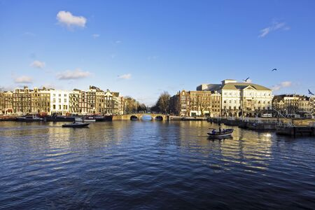 The river Amstel with theater Carre in Amsterdam the Netherlands   免版税图像