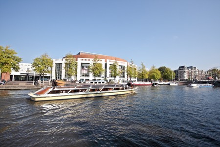 cruiseboat: Cityscenic from Amsterdam in the Netherlands   Stock Photo