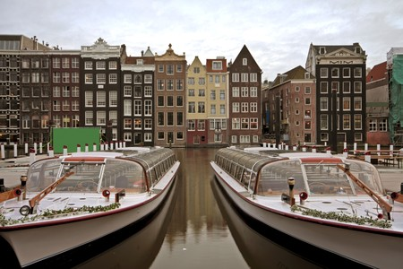 cruiseboat: Amsterdam with houses and cruiseboats in the Netherlands