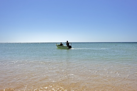 armacao: Fisherboat on the ocean at Armacao de Pera in the Algarve in Portugal Stock Photo