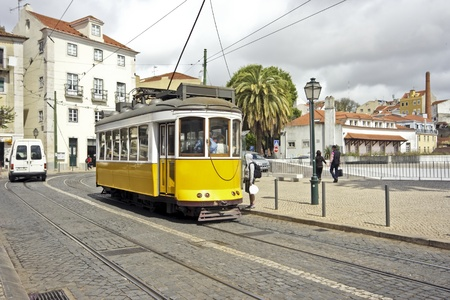 Historical tram driving through Lisbon city in Portugal  Stock Photo
