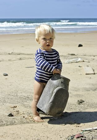 Little baby boy playing at the beach  photo