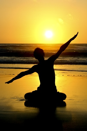Meditation, Love and contemplation, yoga at sunset on the beach  photo