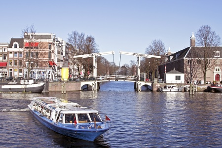 amstel: Cruising through Amsterdam on the river Amstel in the Netherlands  Stock Photo