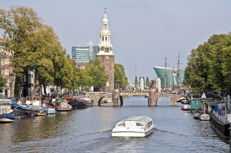 cruiseboat: View on the watertower with cruiseboat in Amsterdam the Netherlands