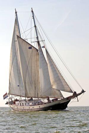 ijsselmeer: Traditional sailboat sailing on the IJsselmeer in the Netherlands