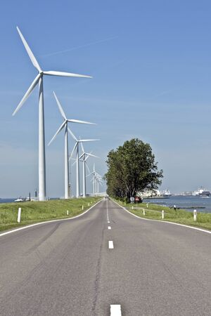 typically dutch: Typically dutch, windmills, road and water Stock Photo