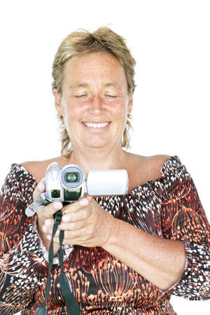 beautiful middle aged woman: Beautiful middle aged woman with video camera Stock Photo