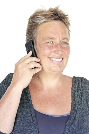 beautiful middle aged woman: Beautiful middle aged woman making a phone call