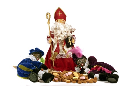 Traditional dutch culture  Santa-Claus and Two black Piet with presents and money at 5th december photo
