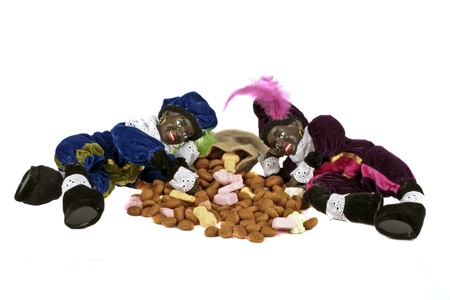 Two black piet with a bunch of gingernuts and sweets for 5 december feast in the Netherlands photo