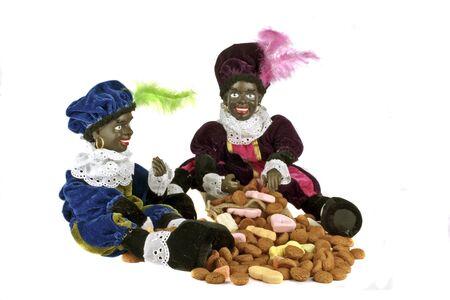 Twee zwarte piet met een stel pepernoten en snoep voor 5 december feest in Nederland