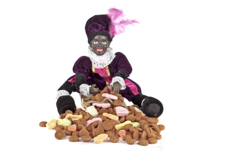 Black piet with a bunch of gingernuts for 5 december feast in the Netherlands Stock Photo - 14645396