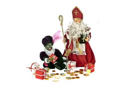 Santa Claus with black piet and presents and sweets on the 5th of december photo