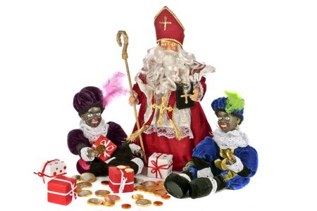 Santa Claus with two black piet and presents and sweets on the 5th of december photo