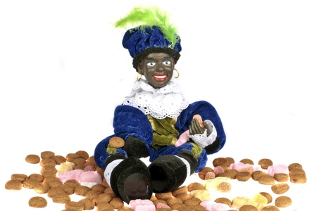 Traditional dutch culture  Black Piet with gingernuts and sweets at 5th december Stock Photo - 14269216