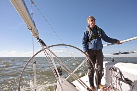 ijsselmeer: Sailing on the IJsselmeer in the Netherlands on a beautiful sunny day  Stock Photo